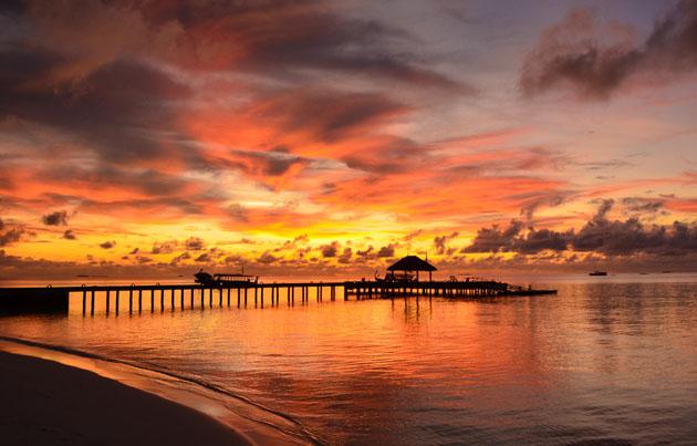 Maayafushis sunset by Omar Bariffi