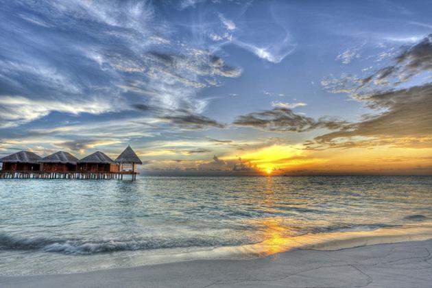 Sunset at Dhigufinolhu Island Maldives by Jon Garcia