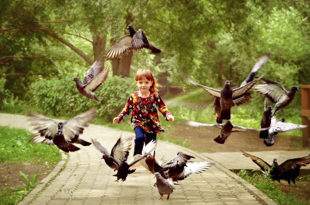 Running girl pigeons by Juliana Vorobyeva