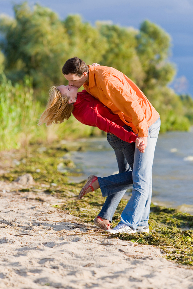 Young love Couple kissed on coast of river.
