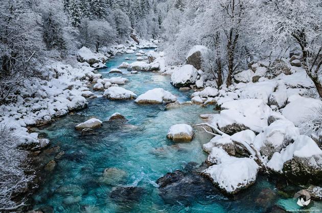 Soca river in snow by Luka Esenko