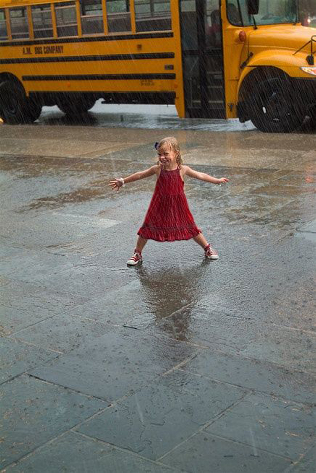 Cute Baby Enjoying Rain Images (1)