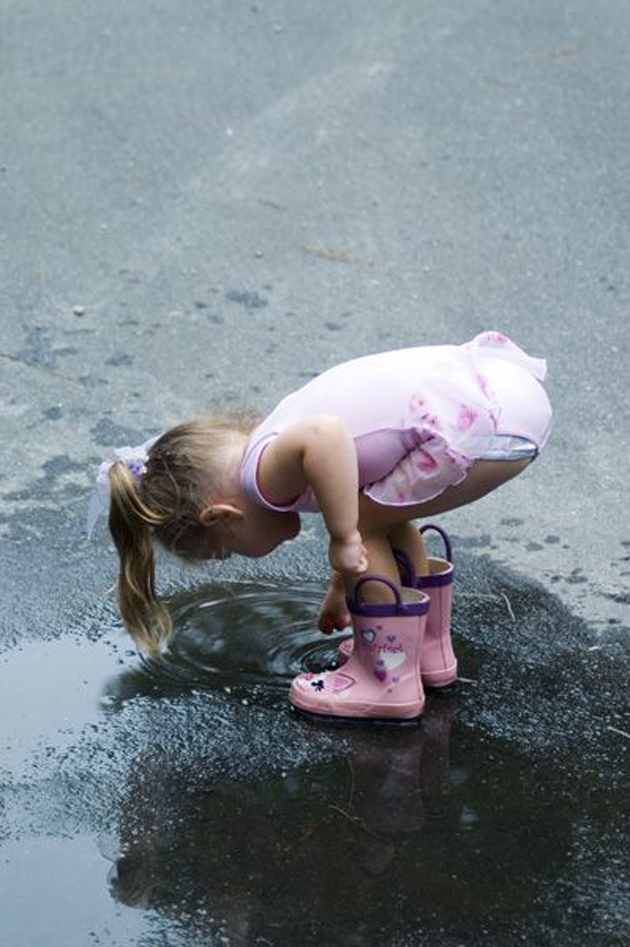 Cute Baby Enjoying Rain Images (2)