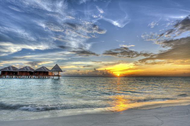 Sunset at Dhigufinolhu Island Maldives by Jon Garcia