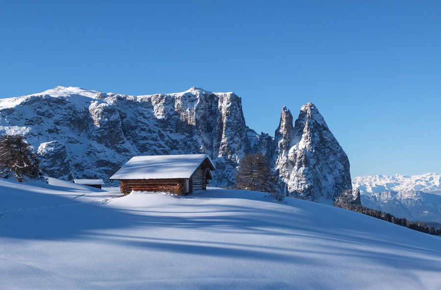 Wooden challet in the Dolomites mountain in winter